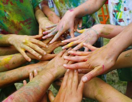Canva - Hands Of Children Painted With Colors